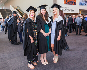 Students wearing the graduation regalia