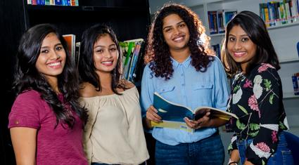 4 students in classroom at ECU Sri Lanka Campus