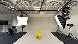 Photography studio with backdrop and flash hoods