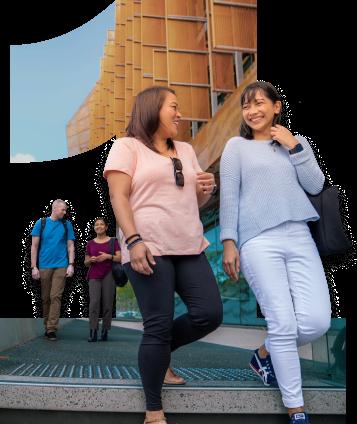 Two women walking past ECU Joondalup Ngoolark building