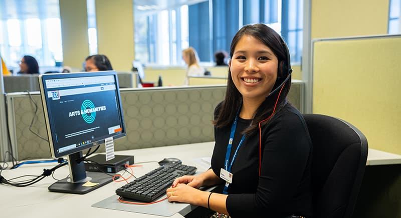 Female student sitting at desktop computer