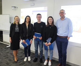 From the left: Dr Violetta Wilk, students Molly Goodwin, James Morrison, Graycen Hannan, and West Coast Eagles' Mr Shane Chapman