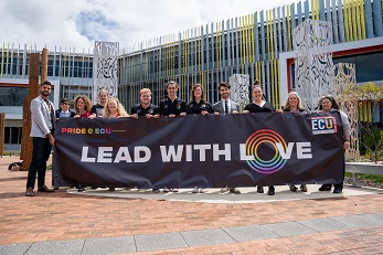 ECU Staff and Students holdings ECU's 2019 pride parade banner that reads Lead with Love