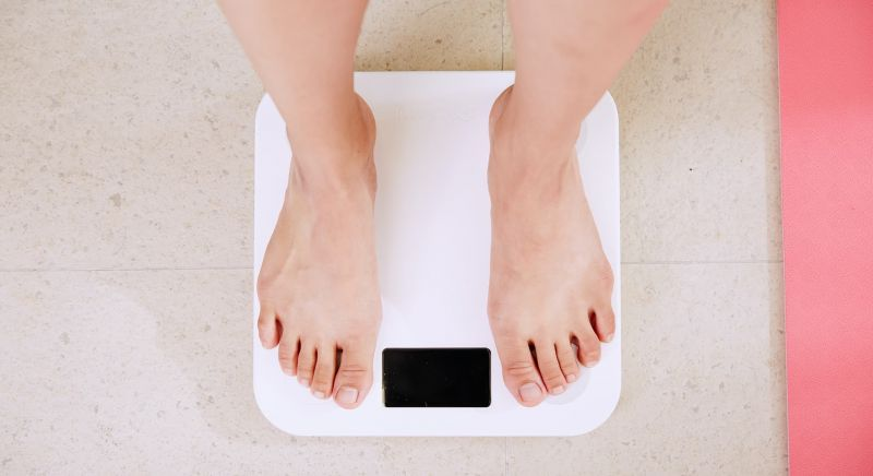 Person standing on scales.