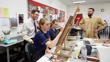 Secondary teaching student, Alexander Gibbs with high school arts students on a teaching practicum.
