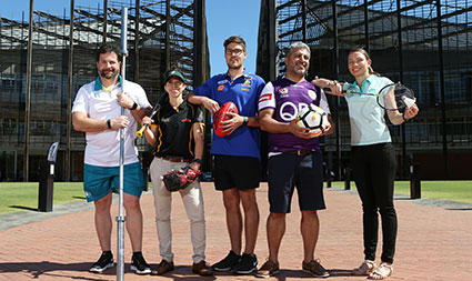 Five people from various sports, with sporting equipment standing in front of building one on ECU Joondalup campus