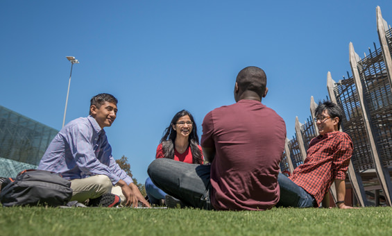 Four International students sitting and talking